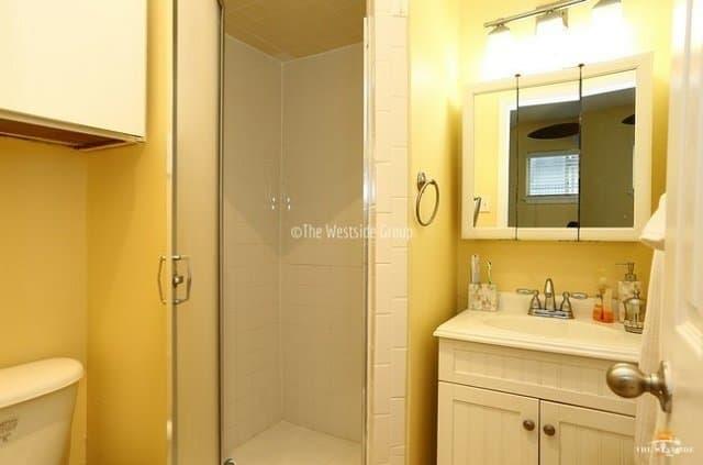 standing shower with updated bathroom fixtures