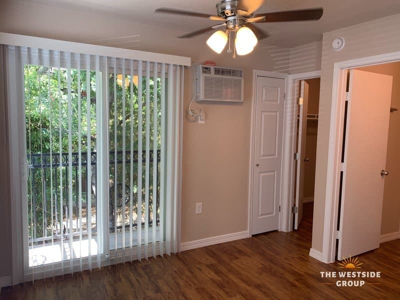 sliding glass door with blinds on austin studio apartment