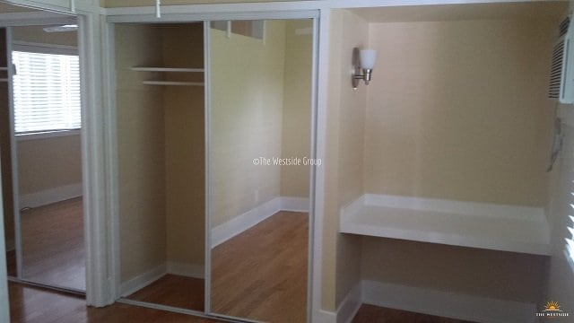 spacious closet with built-in study table