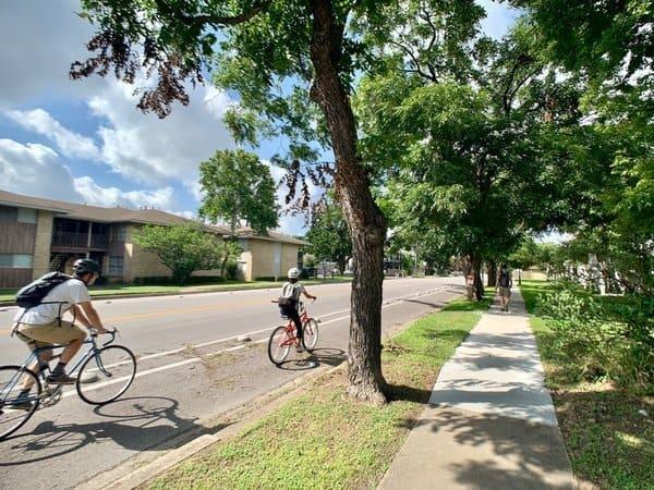 students biking on quiet road